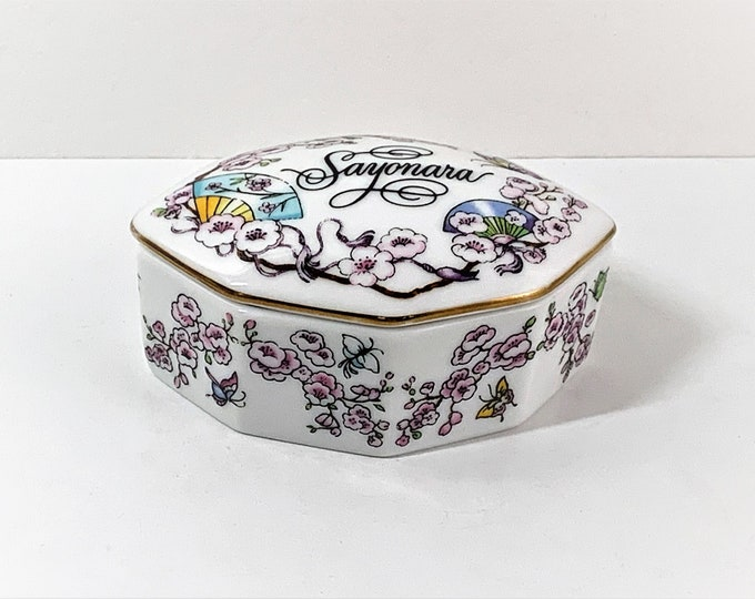 "Franklin Porcelain, The World Most Romantic Love Songs Music Box ""SAYONARA"", Hand Crafted in Japan, 1984. 3"" W. 2"" L. Top Grade Condition."