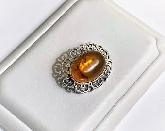 "Vintage Sterling Baltic Amber Brooch, Oval Cabochon Honey Amber 18X13 mm, Cut-Out Scrolls Pattern. 27mm - 1 1/8"", England"
