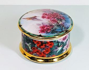 "Lena Liu's Gems of Nature ""the Allen's Hummingbird"" Porcelain Music Box. ©1994 Ardleigh Elliot. Piano Concerto #1. No. 1875 C. 3.5"" Round."