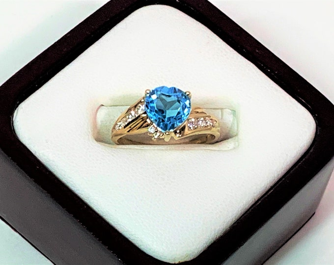 10K Yellow Gold Heart Shape Swiss Blue Topaz Ring, 8 mm Heart, Channel Set White CZ Accents, Size 7 US. 2.50 Grams. Free US Shipping