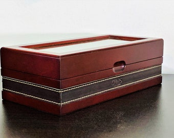 "CHAPS™ Solid Wood Watch Organizer Box, Stylish Leather Accents, Glass Window, Velour Lining, 4 Slots W/Cushions, 9"" W. 4.5"" L. True Luxury."