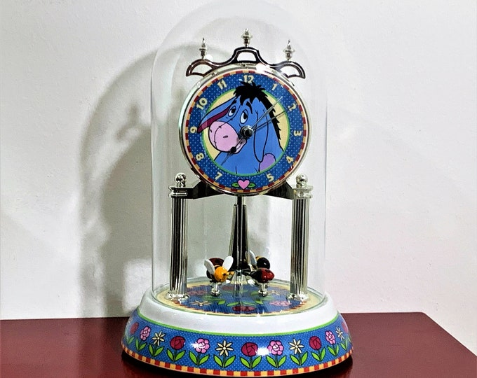 "Licensed Disney Winnie the Pooh Eeyore Collection Anniversary Clock, Glass Dome, Rotating Pendulum Lady Bugs and Bees, 10"" H. 6"" Base. Nice"