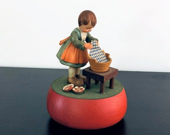"""Vintage Reuge Swiss Music Box 'Raindrops Keep Falling on My Head"""" ANRI Rotating Wood Sculpture 'Girl Washing"""", Great Condition. 5"""" T. 4"""" L."""