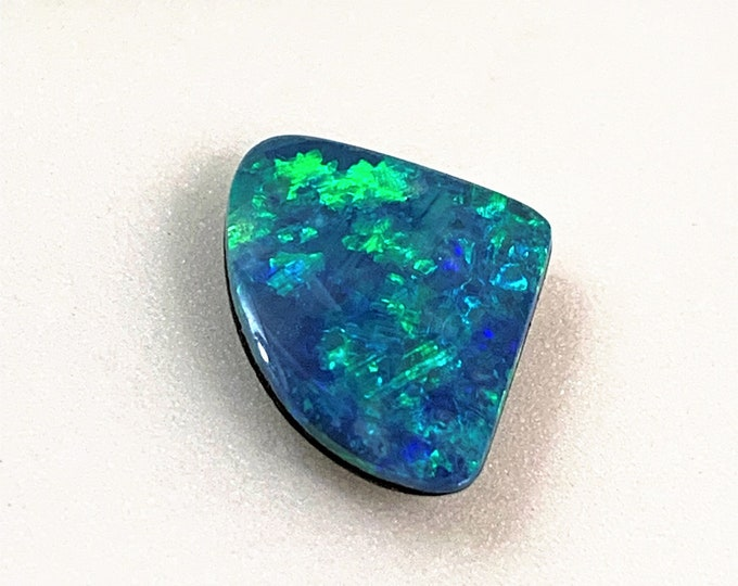 Australian Blue Fire Opal Gemstone, Solid brown Iron Stone Back, 2.69 Carats, 11 X 10.50 mm, Blue - Green and Yellow fire.