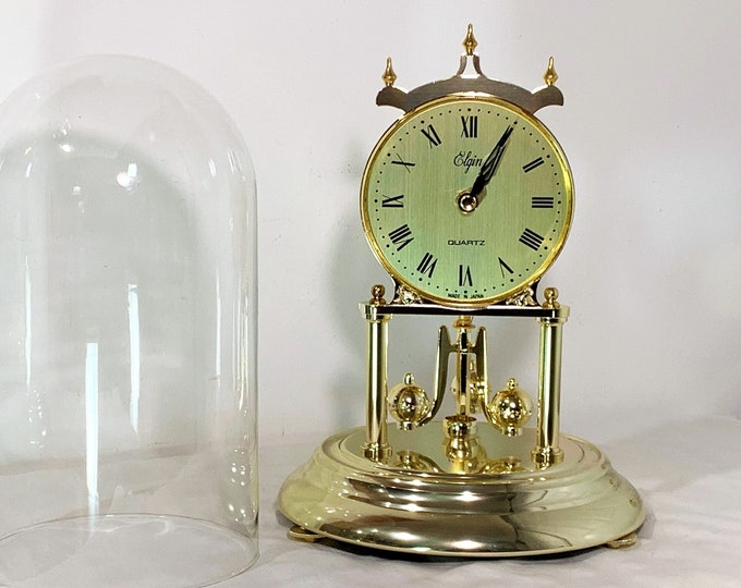 "Elgin Japan Anniversary Clock, Glass Dome, Brass & Brass Finish, Rotating Pendulum, 11"" T- 7.5"" W Base, Mint Condition, Free US Shipping."
