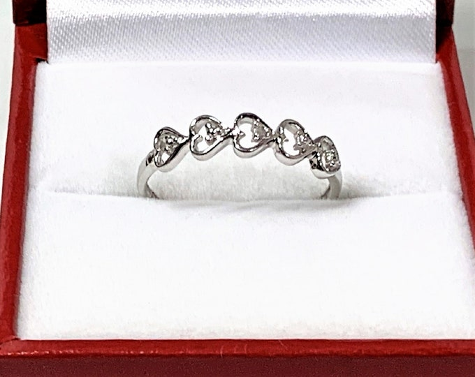 10K White Gold Hearts Band, Signed ZRW, 5 Open Hearts, One Small Diamond in the Middle Heart, Size 7 US, Free US Shipping.