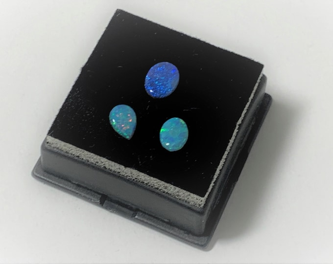 3 Amazing Australian Opals, Fascinating Fire, One Pear Shape and 2 Ovals, 1.97 carats Total Weight.