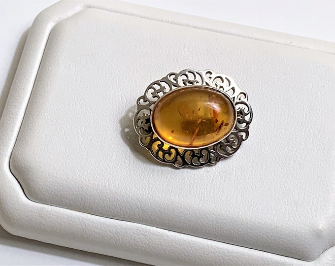"""Vintage Sterling Baltic Amber Brooch, Oval Cabochon Honey Amber 18X13 mm, Cut-Out Scrolls Pattern. 27mm - 1 1/8"""", England"""