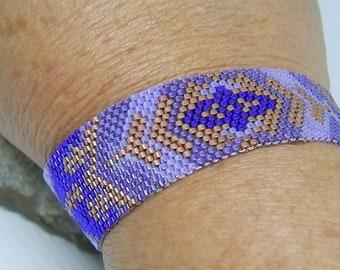 Purple, purple and copper hand-woven bracelet