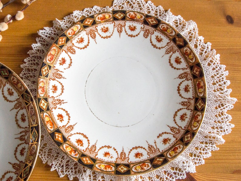 Two beautifully decorated Royal Albert plates early 20th century
