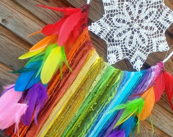 Medium boho dreamcatcher with ribbons and feathers rainbow colorful. Bohemian hanging wall decoration, hippies home style, lgbt, fairy