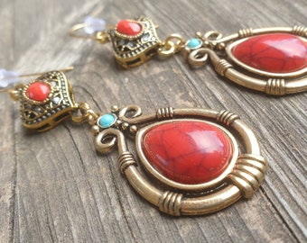 Ethnic fashion gypsy style dangling earrings, oriental spirit. Ethno chic jewel, red and gold aged, hippy chic, boho Ibiza summer fashion