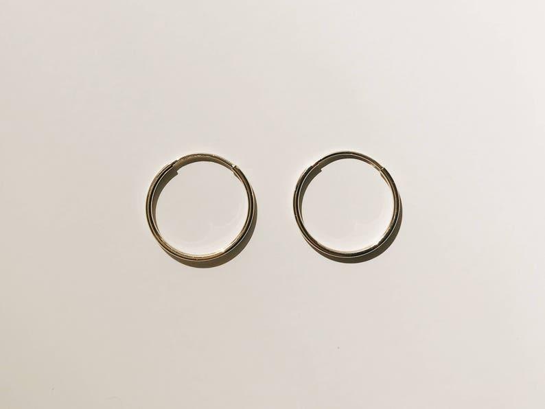 48433bd77 ENDLESS GOLD HOOP earrings / 14k solid gold huggie earrings / | Etsy