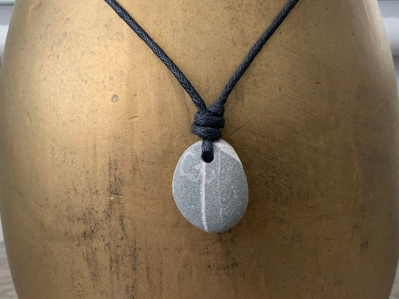 Raw stone pendant, Beach pebble necklace handmade using a natural beach stone strung on a black waxed cotton cord ideal for a man or woman