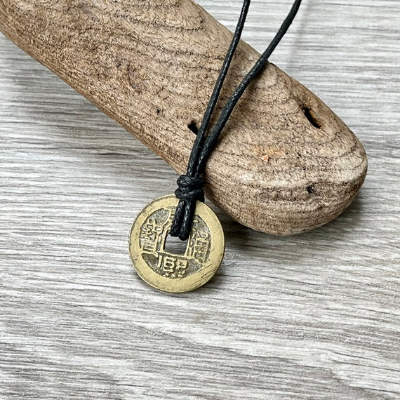 Chinese coin pendant necklace, choose between a black leather cord or a black waxed cotton cord, adjustable knotted cord
