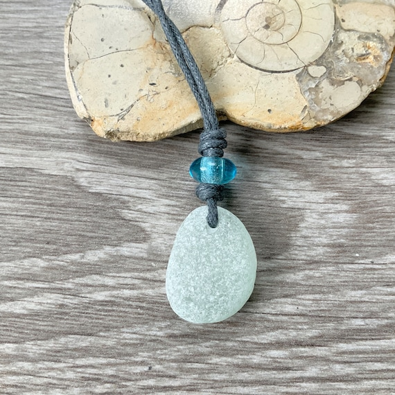 Sea glass necklace, beach glass pendant with a pale blue glass bead on a grey knotted adjustable cotton cord, recycled jewellery