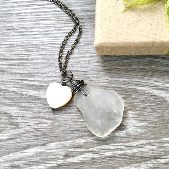 Natural wire wrapped sea glass necklace with a shell heart charm