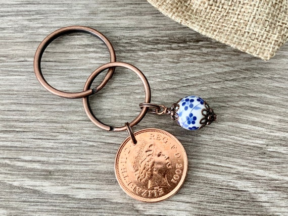20th anniversary gift, china Anniversary, 2001 British two pence coin with a china bead charm on a keyring or clip,