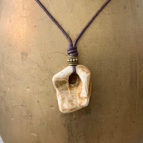 Hag stone pendant with a brown cotton cord, raw stone necklace, beach rock jewellery, knotted necklace, adjustable length