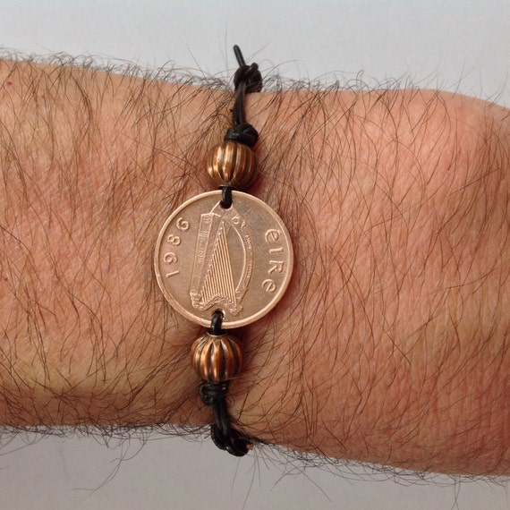 Irish penny adjustable bracelet, choose coin year, handmade with either black leather cord or black waxed cotton cord
