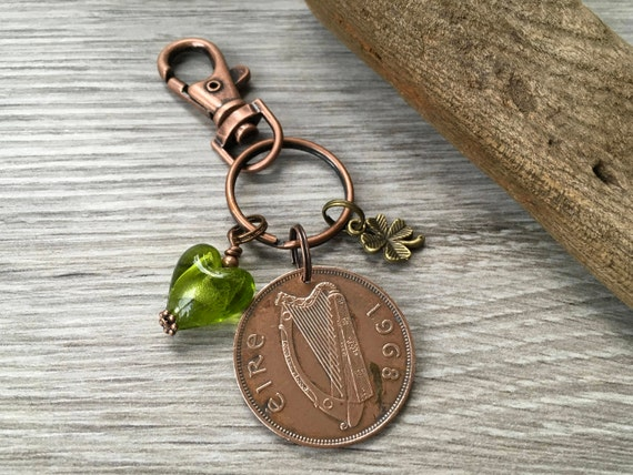 Irish penny lucky charm, 1968 Ireland coin with a four leaf clover and a handmade green glass heart charm
