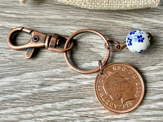 china Anniversary gift, 20th Anniversary, 2000 British coin with a china bead charm on a keyring or clip,