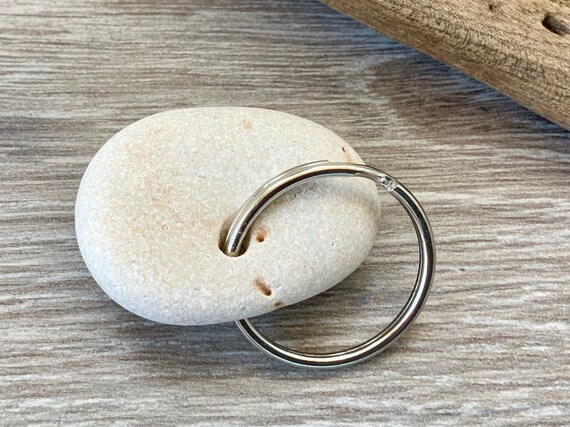 Hag stone keyring, Pebble with a natural hole keyring, rock key chain handmade using a stone found on the beach in Cornwall