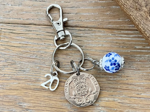 20th birthday or Anniversary gift, 2001 British twenty pence coin keyring or clip with a china bead charm