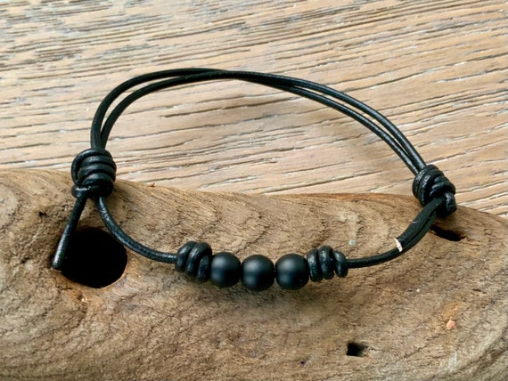 Matt black onyx bead knotted bracelet, simple adjustable jewellery for men or women, handmade with a leather cord