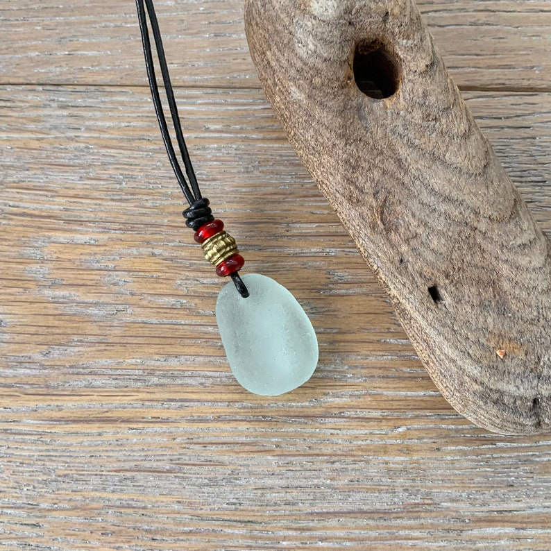Cornish sea glass unisex necklace with red bead and bronze beads boho beach jewellery Natural sea glass pendant