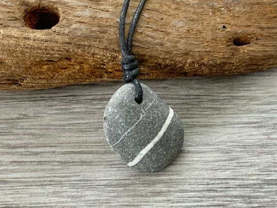 Raw stone pendant, striped pebble necklace handmade using a natural beach stone on an adjustable black waxed cotton cord for a man or woman