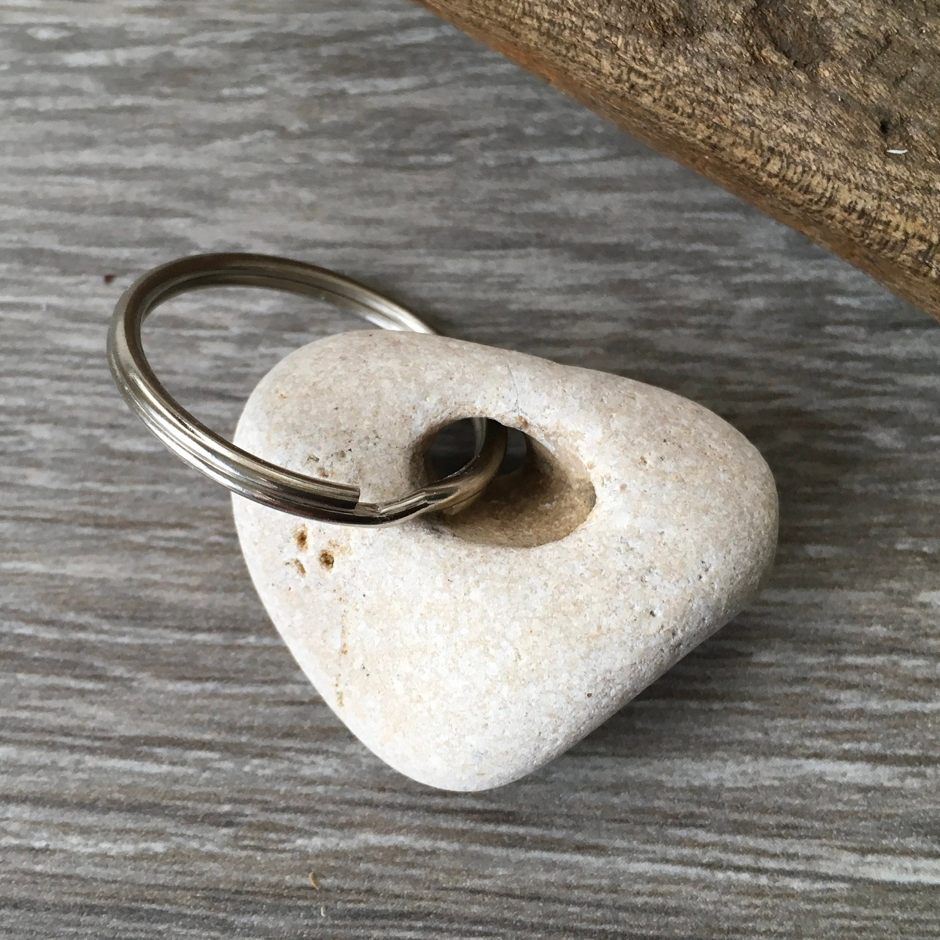 Hag Stone Keyring Beach Pebble Key Fob Beach Rock Key Chain Natural Rock Found Pebble Small Gift For A Man Holey Pebble From Cornwall A hag stone is forged by the power of water, either the sea or rivers, when over centuries the endless action of the waves creates a magical hole within the stone. hag stone keyring beach pebble key fob