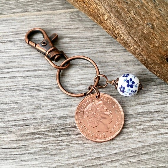 china Anniversary gift, 20th Anniversary, 1999 British coin with a china bead charm on a keyring or clip,