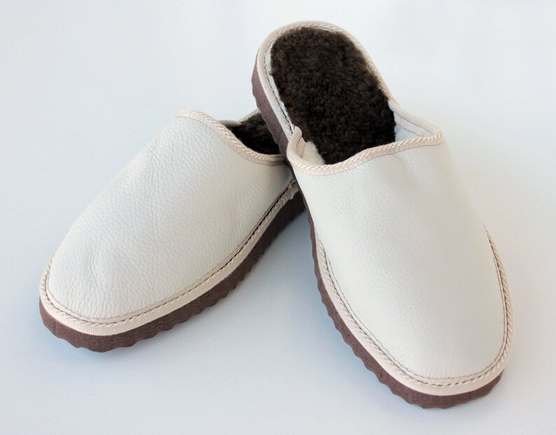 9426bc020d2d8 Men slippers made of white sheepskin leather on top and white fur inside  for extra warmth, totally handmade. A great gift for him or dad