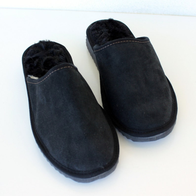817b37db4258b Men slippers made of sheepskin black leather on top and white fur inside  for extra warmth, totally handmade. A great gift for him or dad
