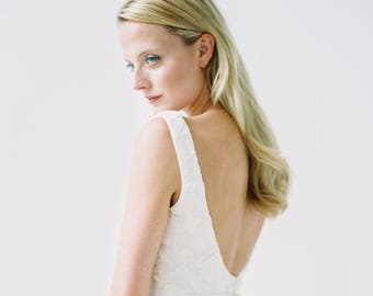 Andrianna // A lace wedding dress with a tulle waterfall skirt and scoop neck