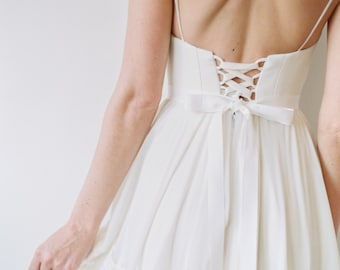 Abbott // A Refined Dress With a Deep V Neckline and Lace-blocked Skirt