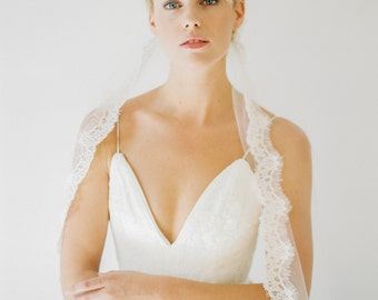 Caudry Veil // A sheer, ivory tulle veil with luxurious corded French lace