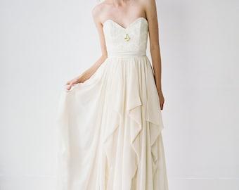 Natalie // A modern, strapless dress with a cascading pick-up skirt