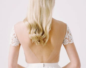 Mary // An open back wedding dress with beaded cap sleeves