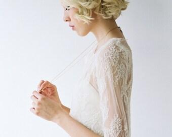 Klara // A refined, chiffon wedding dress with a removable lace shirt
