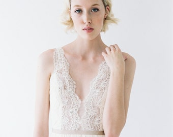 Nicolet // A structured deep-v dress with lace, rose gold sequins, and ruching