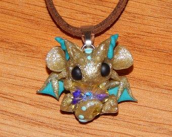 Gold and Blue Dragon with Flower Gem