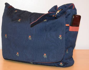 Blue and rust messenger style handbag