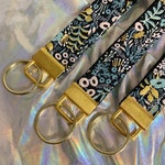 Black floral quilted keychain | rifle paper co with metallic accents