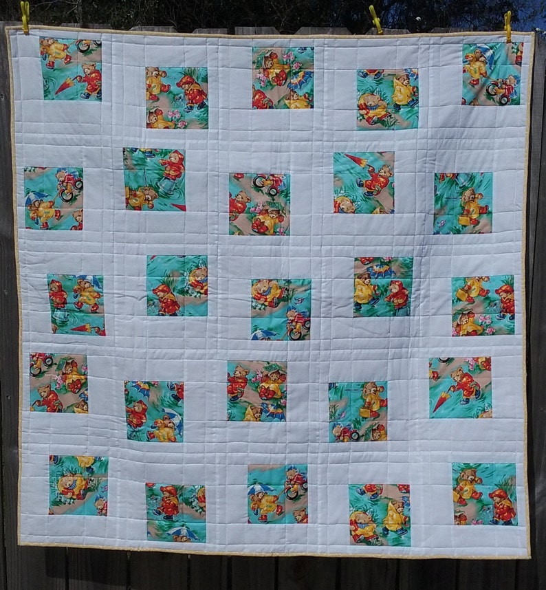 Baby Quilt Blocks.Modern Baby Quilt Floating Blocks Of Paddington Bear Against White Background