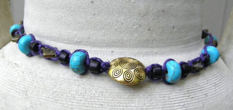 Hemp necklace in purple with brass turquoise and wood beads