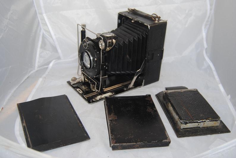 Vintage COMPUR bellows camera w 4 backing film plates.