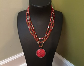 Orange multi strand necklace