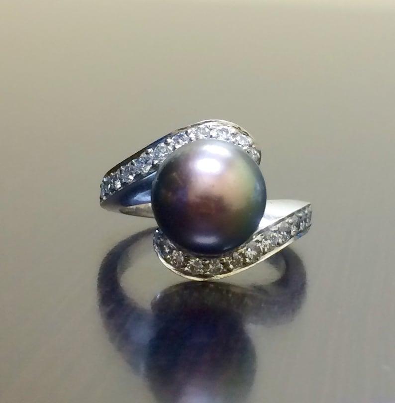 903573cce2fe 18K Art Deco negro perla diamante anillo de compromiso